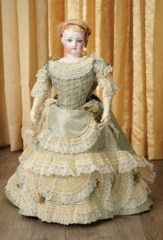 French Bisque Poupee by Gaultier, circa 1875, Wearing costume of aqua silk with lace trim features an elongated train, original undergarments, stockings, shoes and wig.