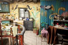 "Interior of the Lovegood House, depicted in ""Harry Potter and the Deathly Hallows: Part 1""- It has a hand-made hippie/witch's cottage aesthetic, similar to many contemporary cob homes."