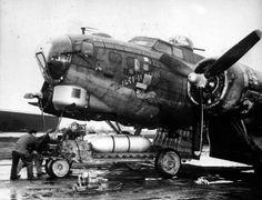 Two napalm bombs being loaded into the 452nd Bomb Group's veteran B-17G 'E-Raticator', April 1945.