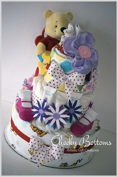Beautiful Sunday in Ottawa for a baby shower! Pooh bear made his way to a mom-to-be in this Pooh inspired creation for a baby girl that is on her way.  This three-tiered diaper cake is created with 55 Pampers Swaddlers, 2 baby receiving blankets, 3 baby Live Clean products, 1 pair booties, 2 baby spoons, 4 baby washcloths, 2 body suits and 1 Pooh rattle/toy.