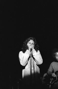 "the60sbazaar: "" Jim Morrison onstage (Robby Krieger just pictured) """