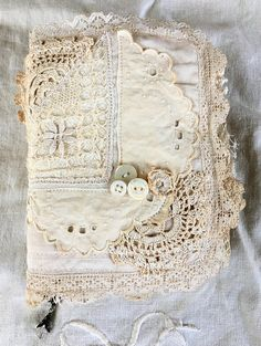 Beautiful one of a kind handmade journal For the cover Iv used vintage linens, doilies and vintage buttons. Inside you will find 16 linen and lace pages not counting the sheer fabric pages. There are 13 pockets, one on the back cover, tuck spots and belly bands. To one of the pages Iv