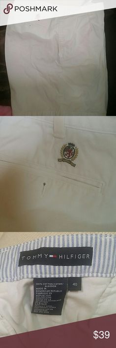 SZ 40 WAIST TOMMY HILFIGER POLO STYLE SHORT 100% cotton thicker, white, stiff like material. Very nice!  Slit front pockets. Slit and button back pockets with logo on right side just above pockets shown in pic 2. Zip button front fly as well with waist band and belt loops.  Thanks for visiting my closet! Come again soon! Make me an offer! I love offers! I need offers please! Tommy Hilfiger Shorts