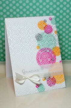 Jessica's card, using a white-stamped clear sheet overlay--wow!