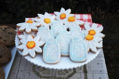 Mason jars and flower decorated cookies for a bbq couples shower Frenchpresspastries.com