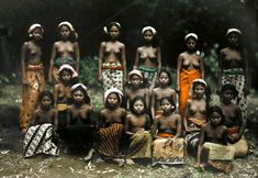 1928, Bali, Indonesia --- Balinese dancers pose for a picture before their performance --- Image by Franklin Price Knott