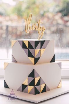 """30th Birthday Cake      6"""" Lemon Victoria Sponge cake  8"""" White Chocolate Mud cake  Layered with white chocolate ganache Covered with sugar paste ( fondant)    24 carat edible gold leaves applied for the triangles"""
