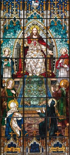 """""""We illustrate the indebtedness of our center to both St. Thomas Aquinas and Blessed John Newman in the stained glass window above the high altar. It's the largest stained glass window installed in a Catholic Church in 100 years. It was built in Munich by Franz Mayer & Company. Measuring 20x24 feet, it pictures Christ on the heavenly throne surrounded by angels and saints that have to do with either learning or working with youth. To his right is St. Thomas, the Angelic doctor and great…"""