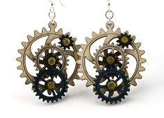 """No need to ruffle your bustle! These interconnected gears will keep you on track. The best part? All gears move!  These intricate wood earrings are laser-cut for precision, dyed aquamarine and black satin surrounded by natural wood.  They're lightweight, sustainably-sourced, made in the USA, use water-based dye, and the ear wires are silver-finished 3041 stainless steel with new electrophoretic-coating that resists tarnishing  Size 1.65"""" x 1.5"""""""