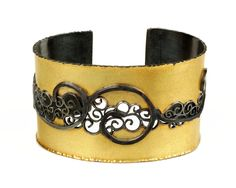 Gold and black silver cuff with filigree