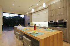 Astonishing Large Stand Alone Kitchen Islands and Half Back Counter Stools with Square Stainless Steel Furniture Legs also Under Kitchen Cabinet Strip Lighting from Kitchen Island Plans
