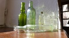 Green Glass Bottle collection Bottles with embossed writing
