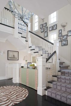 If I ever have a 2-story house with stairs, I'm totally doing this. Canvases would be great, too!