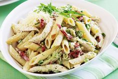 Creamy Chicken Pesto Pasta - Use up leftover roast chicken, or buy a barbecued chicken from the supermarket, and turn it into this super easy pasta dish.