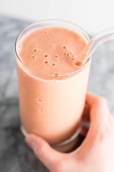 This carrot cake smoothie recipe makes a great healthy breakfast or dessert! Made with raw carrots, frozen bananas, milk, greek yogurt, maple syrup, and spices. Add extra veggies into your day with this delicious smoothie!
