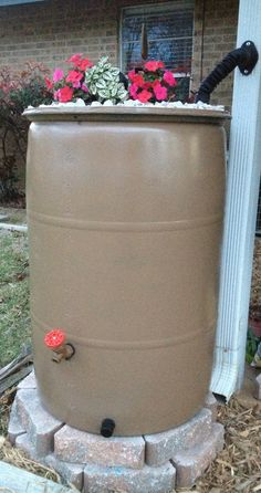 My DIY rain barrel turned out great! Total cost around $65 for rain kit, landscape brick, spray paint, 55gal barrel, and pebbles on top!