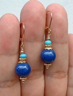 "Delightful Lapis Beads (10mm) with gold plated spacer accents topped by Turquoise Beads (4mm). The earrings are 1.5"" long."