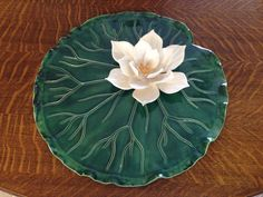 A personal favorite from my Etsy shop https://www.etsy.com/listing/263464294/handmade-pottery-dish-lily-pad-and-lotus