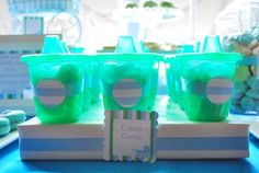 Cotton candy filled sippy cups.  See more 1st boy birthday favors and party ideas at one-stop-party-ideas.com