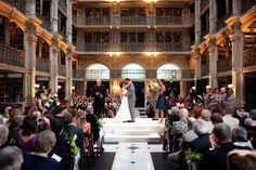 I like that people sit in both sides. Bridal party not on stage with bride and groom. Peabody Library