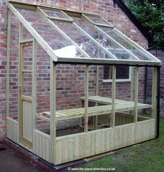 greenhouse....this is what I would like on the side of the garage that Mark finally builds me at the house. I have the perfect spot facing south. Maybe I can convince him to put the in floor heating into that garage also AND extend it to my greenhouse :-)