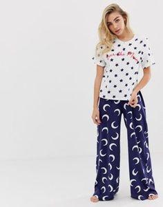 43170266876 Shop ASOS DESIGN over the moon tee & wide leg pyjama set at ASOS.