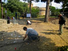 Students of the 2013 Field School program getting the excavation site ready for the press conference.