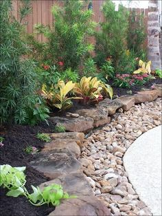 for around the concrete on pool. Layered gravel and then stacked stones with plantings. LOVE THIS! Natalie