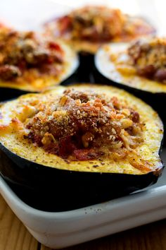 NYT Cooking: This makes a substantial vegetarian – or vegan if you leave out the cheese – Thanksgiving main dish. It is another riff on the native American tradition of the Three Sisters – corn, beans, and squash. I used acorn squash here, and it serves as a vessel for the sweet and pungent bean, corn and tomato filling. Acorn squash comes in various sizes