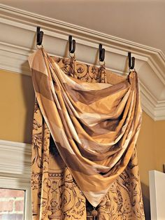 An elegant patterned fabric is paired with separate silk swags, which are weighted down by beaded tassels