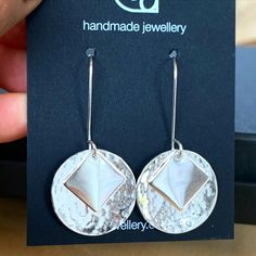 These layered silver drop earrings have been hammered and polished, and were made in private workshop by a lovely mum with her daughters on a few days away.