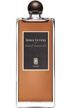 Santal Majuscule by Serge Lutens is a warm, spicy, rosey Oriental Woody fragrance that features sandalwood, cacao and damask rose. - Fragrantica