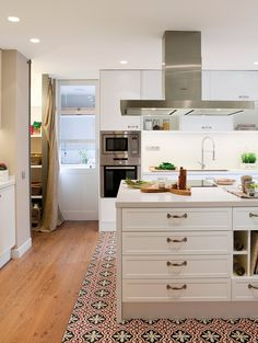 Lovely white kitchen with taupe walls. The wooden flooring continues from the living and dining areas and cleanly transitions to tiles just before the kitchen island all the way into the kitchen. Best Flooring, Grey Flooring, Kitchen Flooring, Kitchen Cabinets, Tile Flooring, Flooring Ideas, Wooden Flooring, Kitchen Island, Grey Kitchens