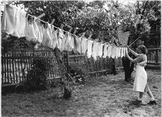 washing vintage clothes. There were rules on how to hang things, so the laundry line look tidy.