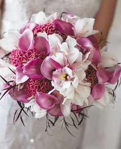 Bouquet of cymbidium orchids, coxcombs, calla lilies, astilbes, and black-tipped foliage