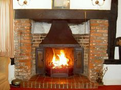 Dovre 2000 wood burning fireplace fitted into this old Essex inglenook, Chelmsford Essex by Scarlett Fireplaces 2004