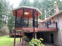 TimberTech Evolutions Full Deck Addition with outdoor game room, gazebo, and deck drainage system, Albany, Oregon.