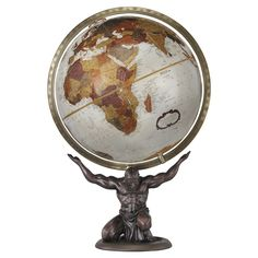 The unique desktop globe shows focused strength with Atlas holding up the world. This detailed bronze patina resin replica illustrates deep earth tone colors, full raised relief cartography and a full metal die cast meridian with antique finish.