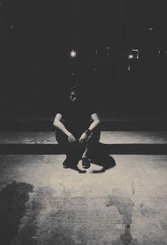 Lonely Man Sitting On Footpath In Dark
