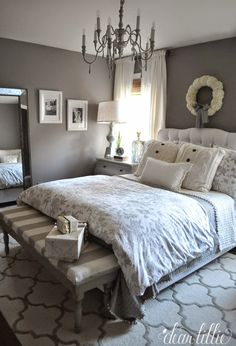 This standing mirror from HomeGoods adds a bit of glam to this dark gray bedroom. #manchesterwarehouse