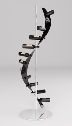 Spyro - A spiraling wine rack designed by Maurizio Ciabattoni as part of the Mast Elements impressive array of carbon fibre furniture. More images: http://mmminimal.com/spyro-wine-rack/