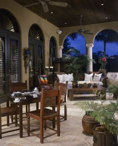 Traditional Patio with exterior terracotta tile floors, exterior stone floors, Arched window, St. James Sleigh Daybed
