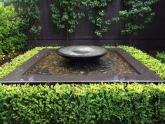 Image result for sandstone ball water feature with planting