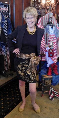 Cheryl is looking super FAB in our Gold Embellished Skirt, Black Blazer and sassy accessories: Gold Metallic Flats, Leopard Scarf, and Layers of Gold Chains. Come get this look!