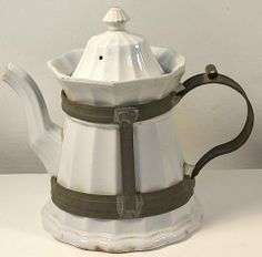 English Ironstone Tea or Coffee pot, circa 1845-65 with Tinsmith made replacement handle attached to a conforming tin cage