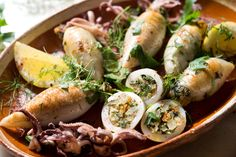 NYT Cooking: Squid (or calamari, its Italian name) can be prepared in a variety of ways — fried, braised, grilled and roasted — and all are good. In this recipe whole squid are stuffed before roasting with a bread crumb filling that contains typical Sicil Squid Recipes, Fish Recipes, Seafood Recipes, Cooking Recipes, Easy Cooking, Cooking Ideas, Seafood Dishes, Fish And Seafood, Comida Siciliana