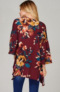 The side cuts make this cardigan able to be tied as well. Floral Cardigan, Kimono Cardigan, Open Cardigan, Floral Tops, Floral Prints, Side Cuts, Quarter Sleeve, Tunic Tops, Wine