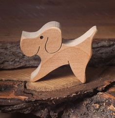 An dog wooden aninal figure is a great present for children. It is a really cute pet made from wooden for toddlers.