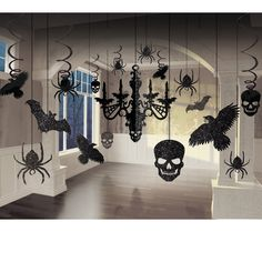 "Glitter Chandelier Kit    Overall Rating: review rating be the first to write a review  This Kit includes (17) glitter cardboard decorations that nclude: 1- 16"" chandelier, 2 - 5"" skull cutouts, 2 - 4.5"" bat cutouts, 2 - 7.5"" raven cutouts, 2 - 5.25"" spider cutouts, 2 - 3.5"" spider cutouts, 2 - 24"" spiral spider decorations, 2 - 24"" raven swirl decorations, 2 - 24"" skull swirl decorations. 12.99"