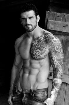 Shirtless male model with tribal tattoos